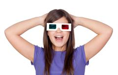 Surprised girl with three-dimensional glasses Stock Photos