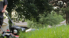 HD Stock Footage - Teen mowing yard, slowed 50 percent in post = AUDIO Stock Footage