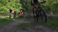 Stock Video Footage of Mountain bikers passing by in slowmotion 400fps