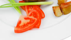 Meat food : roasted fillet mignon on white plate with tomatoes a Stock Footage