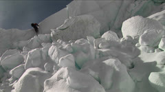 Climber using ladder in the icefall Stock Footage