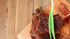 Boned roasted lamb ribs served with green chives Stock Footage