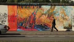 Business man passing in front of street graffiti Stock Footage