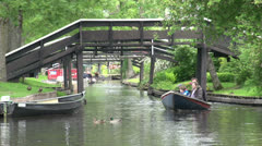 Boat trip on channel in Giethoorn Stock Footage