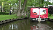 Stock Video Footage of Boat trip on channel in Giethoorn
