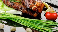 Served entree: ribs on plate with hot peppers Stock Footage