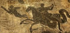 Ancient roman woman on horse cupid  floors baths of neptune ostia antica rome Stock Photos
