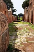 Ancient roman road ruins ostia antica rome italy Stock Photos