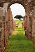 Ancient roman arch walls street ostia antica rome italy Stock Photos