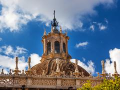 dome cathedral of saint mary of the see spire weather vane seville spain - stock photo