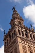giralda bell tower cathedral of saint mary of the see spire weather vane sevi - stock photo