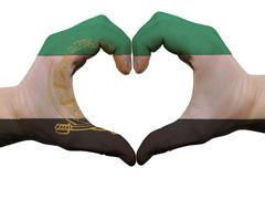 Heart and love gesture in afghanistan flag colors by hands isolated on white Stock Photos