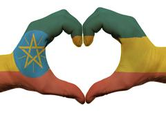 heart and love gesture in ethiopia flag colors by hands isolated on white - stock photo