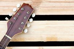 detail of mandolin headstock background concept - stock photo