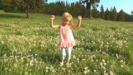 Child Dancing in Dandelion Flowers, Mountains, Girl Playing on Meadow, Children Stock Footage