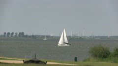 Sailboat and heavy industry Stock Footage