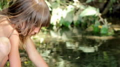 boy washes his face at a forest stream - stock footage