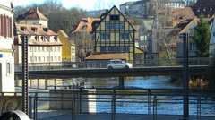 Bamberg old town bicycle biker along Regnitz river canal Stock Footage