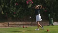 Female golfer tees off Stock Footage