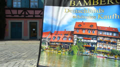 Stock Video Footage of Germany Bavaria Franconia Bamberg postcard display for sale