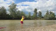 Child Playing at Mountain River, Girl Throwing Stones in Stream Water, Children Stock Footage