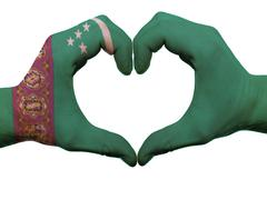 Heart and love gesture in turkmenistan flag colors by hands isolated on white Stock Photos