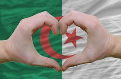 Heart and love gesture showed by hands over flag of afghanistan background Stock Photos