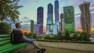 Stock Video Footage of The man sitting by sky-skrapers, timelapse, RAW VIDEO:6K,4K & 1080p resolutions