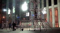Workers at night are washing the showcases of the central Apple store. NYC, USA. - stock footage