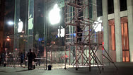 Stock Video Footage of Workers at night are washing the showcases of the central Apple store. NYC, USA.
