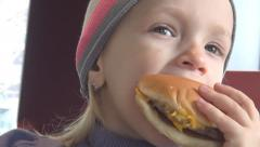 Child Eating Hamburger at Restaurant, Closeup of Hungry Girl Eating Fast Food Stock Footage