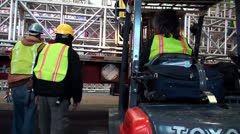 Workers at night is mounted the stage in Times Square. Stock Footage