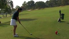 Woman golfer tees off Stock Footage