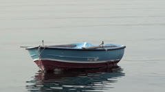 Blue-red boat balance on water Stock Footage