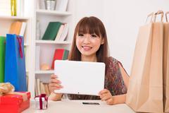 korean female using tablet at living room - stock photo