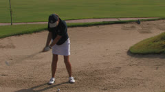 Female golfer in sand pit Stock Footage
