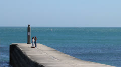 Young Couple on a Pier Stock Footage
