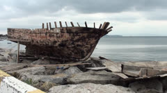 Old ship skull on the shore - stock footage