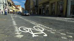 Bicycle Bike lane in crosswalk zebra cross traffic Stock Footage