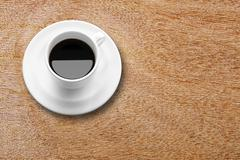 Black coffee in white cup on wood table Stock Photos