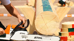 Men's chainsaw log cutting Stock Footage