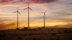 Wind-powered electricity in the desert at sunset Stock Footage