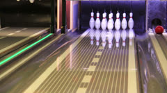 Bowling Strike - ball hitting pins in the alley - stock footage