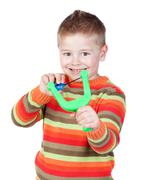 adorable child with a slingshot - stock photo