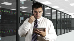 Young Man Talking Phone Tablet PC CPU Server Unit Room 2 Stock Footage