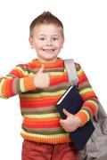 student child with books saying ok - stock photo