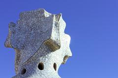 Cross-shaped chimney created by antonio gaudi. Stock Photos