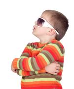 funny child with sunglasses - stock photo
