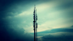 Telecommunication Tower Among The Clouds - blockbuster 23.98 FPS Stock Footage