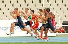 Competitors on start of 100m of Decathlon Stock Photos